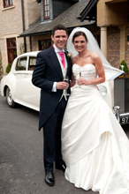 Wedding Photography  bride and groom by the car